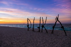 The sign of puka beach during the sunset