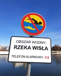 The sign prohibiting swimming in the navigable river. The inscription: