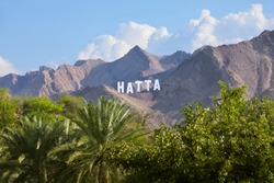 The sign with the name of the town of Hatta in the Emirate Dubai, United Arab Emirates