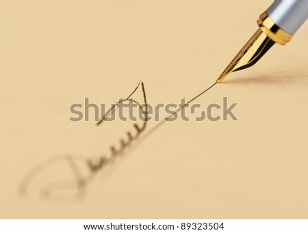 The signature close up and fountain pen.Old yellow paper. Selective focus