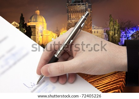 The Signature of Business Contract in front of night Prague