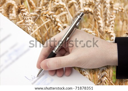 The Signature of Business Contract in front of the Cornfield