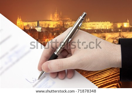 The Signature of Business Contract in front of the Prague Panorama