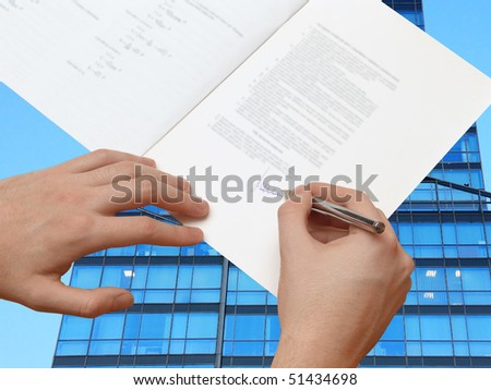 The Signature of Business Contract in front of the Skyscraper