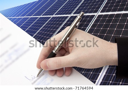 The Signature of Business Contract in front of the Solar Power Station in the green Nature