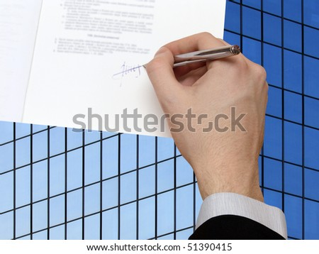 The Signature of Business Contract in front the Skyscraper