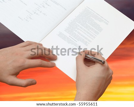 The Signature of Business Contract on the dramatically Sky