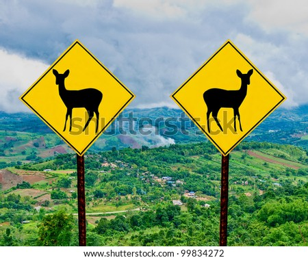 The Signpost of deer  on mountain view background