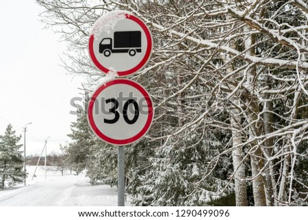 The signs indicate truck prohibited and the speed limit of 50km/h