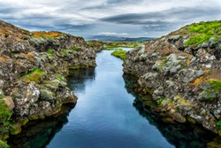 The Silfra fissure between the North American and Eurasian continental plates located in Thingvellir National Park. Beautiful clear water that you can see rocks under the water.