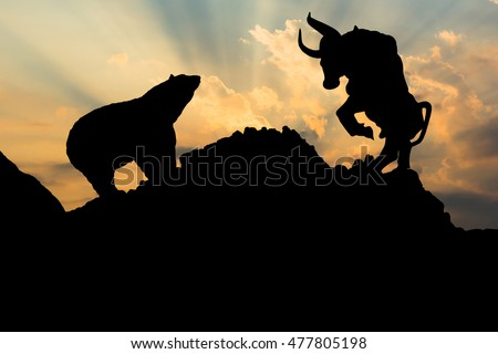 the silhouette of a bear and...