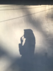 The silhouette of a restless and hopeful Muslim woman