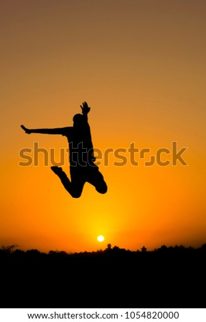 The silhouette of people jumping with sunset background,concept of happiness, joy, joyful life #1054820000