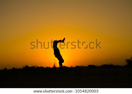 The silhouette of people jumping with sunset background,concept of happiness, joy, joyful life #1054820003