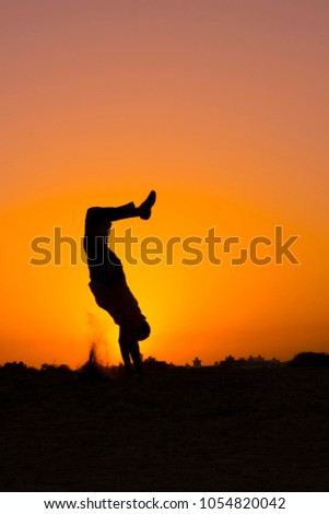 The silhouette of people jumping with sunset background,concept of happiness, joy, joyful life #1054820042