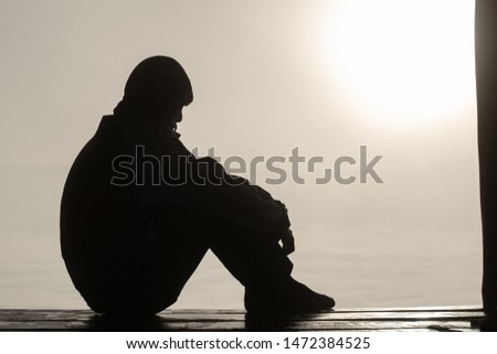 The silhouette of stressed and depressed man  of working  under pressure and hopefulness, Sad expression, sad emotion, despair, sadness. #1472384525
