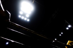 The silhouette of the boxing ring in the dark with the light.