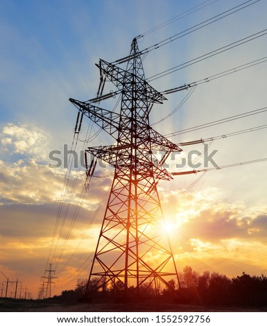 The silhouette of the evening electricity transmission pylon. Power transmission from a power plant to a city Stock photo ©