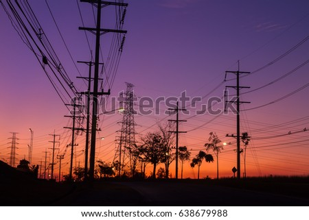 The silhouette of the high voltage towers, electricity post and tree which have a beautiful background. #638679988
