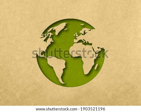 The silhouette of the planet in the style of paper clippings. Ecological concept. Green planet. Earth Day. Mother Nature. Recycling. Biodegradable material.