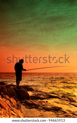 the silhoutte of people standing on the rocks while fishing