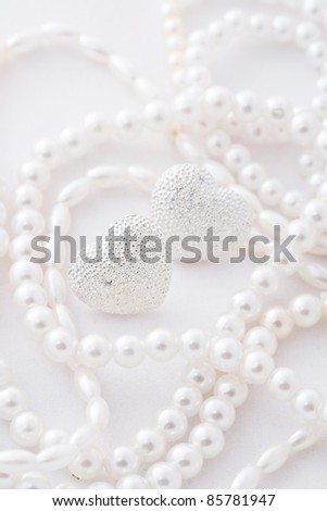 The silver hearts on white background