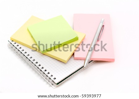 The silver pen lying on a notebook on a white background