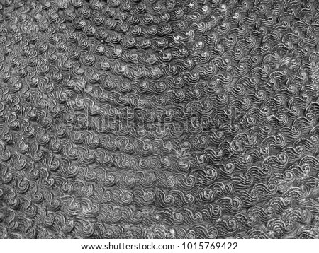 The silver surface is a curved, curved pattern. #1015769422