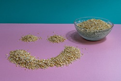 The simple life, oatmeal breakfast picture with interesting colours, cool pink and blue.  Start the day with a smile, great lighning in picture.  Original smily face, cornflakes corn, healthy food