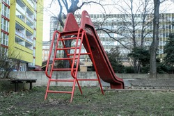 The simple, shabby and unused playground for the children during the winter season.