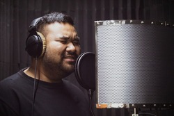 The singer is recording in the studio, Modern recording room,Professional singer