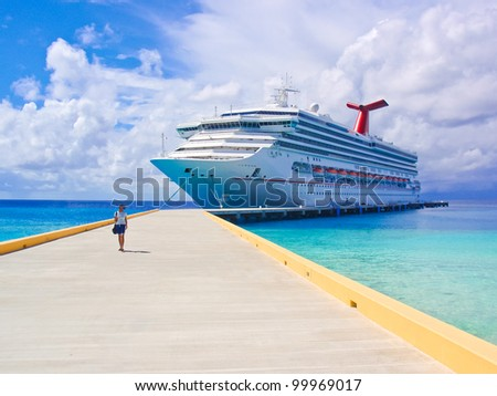 The single female tourist and a big passenger ship in port.