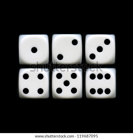 The six sides of a Dice on a black background.