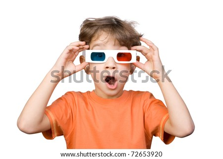 The six-year boy with surprise looks through glasses with three-dimensional effect