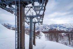 The ski chairlift upto mountains peak of Yuzawa City, Minamiuonuma District, Niigata, Japan.