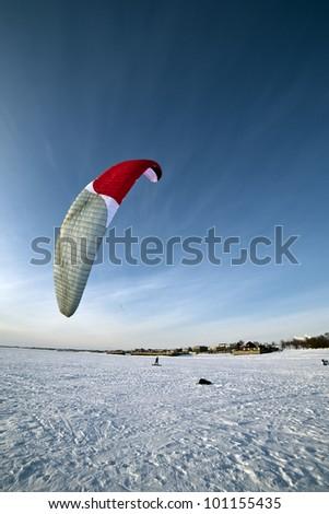 the Ski kiting on a frozen lake