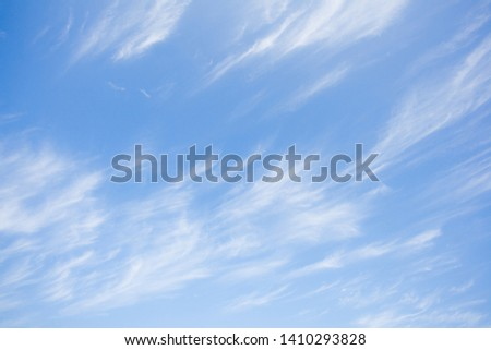 The sky and the bright white clouds that are soft, light and comfortable.