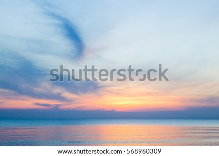 The sky at sunset on the beach #568960309