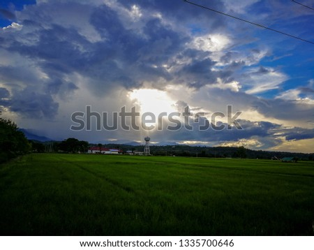 The sky in the fields in the rainy season #1335700646