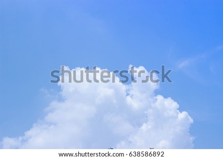 The sky is bright and the clouds are bright and bright blue.  #638586892