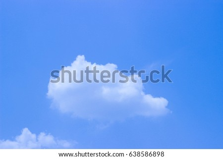 The sky is bright and the clouds are bright and bright blue.  #638586898