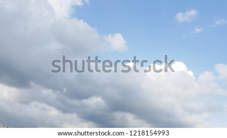 The sky is bright with clouds. #1218154993