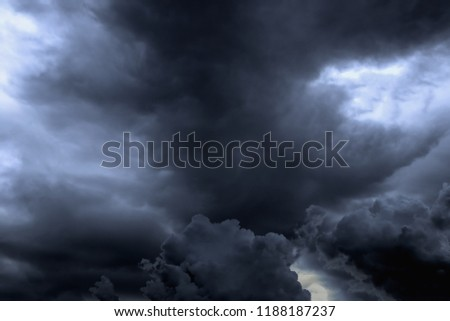 The sky is full of dark clouds in bad weather before a big storm rain.