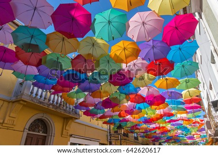 The sky of colorful umbrellas. Street with umbrellas.Umbrella Sky Project in Agueda, Aveiro district, Portugal. Agueda.Background colorful umbrella street decoration.