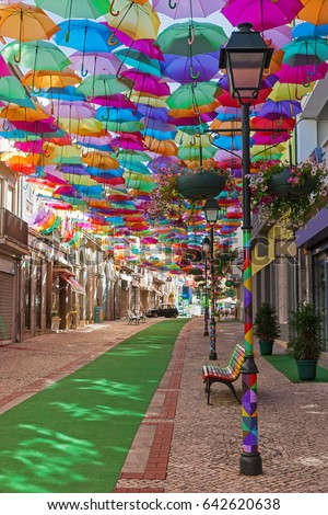 The sky of colorful umbrellas. Street with umbrellas.Umbrella Sky Project in Agueda, Aveiro district, Portugal.Street decoration.Street decorated with colored umbrellas, Agueda.