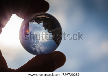 The sky reflected in the crystal ball #729720289