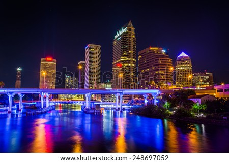 The skyline and bridges over the Hillsborough River at night in Tampa, Florida.