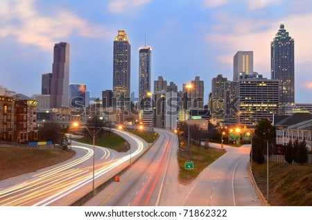 The skyline of Atlanta, Georgia above Freedom Parkway at night.