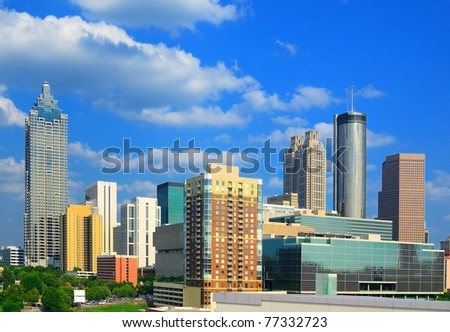 The skyline of Atlanta Georgia with downtown corporate building logos visible.
