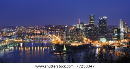 The skyline of Downtown Pittsburgh, Pennsylvania at twilight.